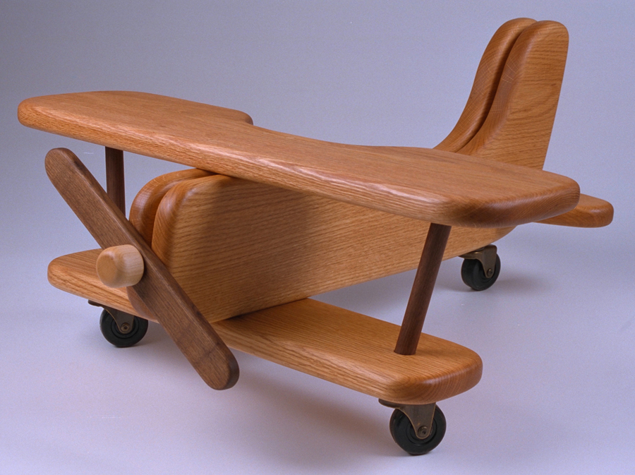A Toy Wooden Riding Airplane